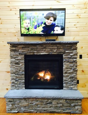 Rock fireplace and TV